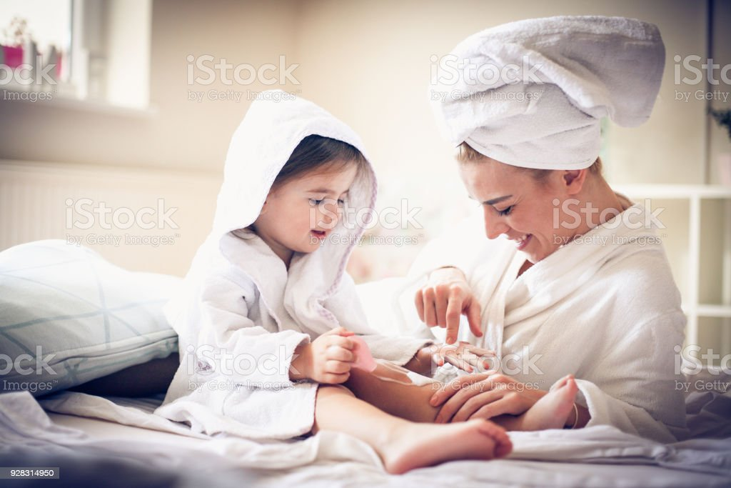 Mother and daughter tae care of etch other. stock photo