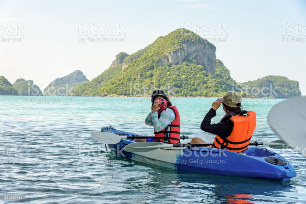 Mother and daughter take pictures on kayak stock photo