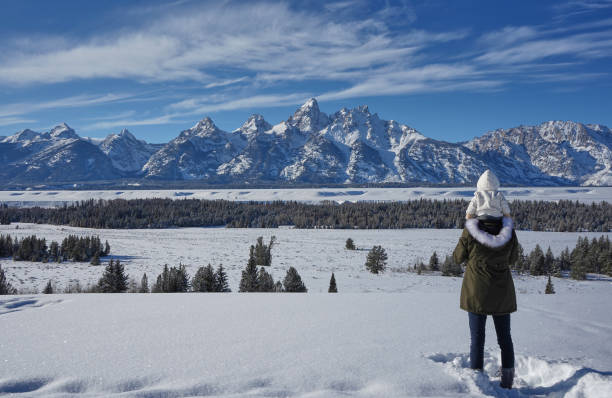 Mother and Daughter Taking in the View in the Winter at Christmas in the Grand Tetons National Park and Yellowstone National Park USA stock photo