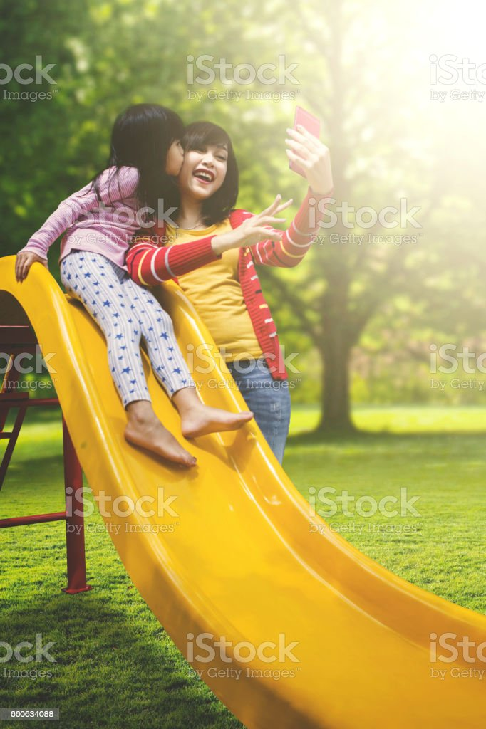 Mother and daughter taking selfie stock photo