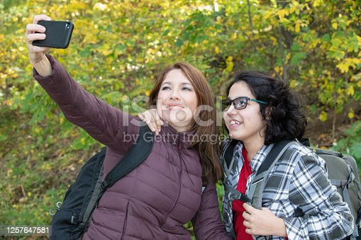 Mother and daughter having fun outside in nature
