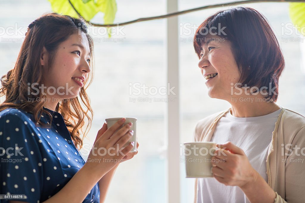 mother and daughter talking stock photo