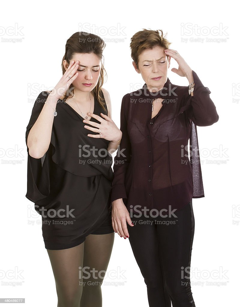 mother and daughter terrible headache royalty-free stock photo