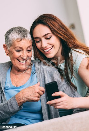 Mother and daughter using a smartphone.