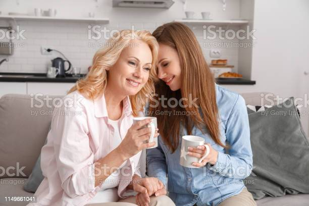 Mother and daughter together at home weekend drinking hot tea picture id1149661041?b=1&k=6&m=1149661041&s=612x612&h=tzeugsw9clqocpkshmhioh5g2j812j7abr0xq5hgzyo=
