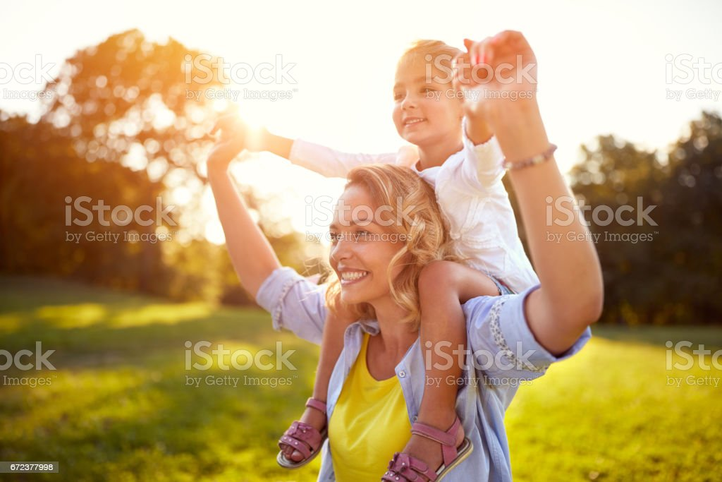 Mother and daughter together in park stock photo