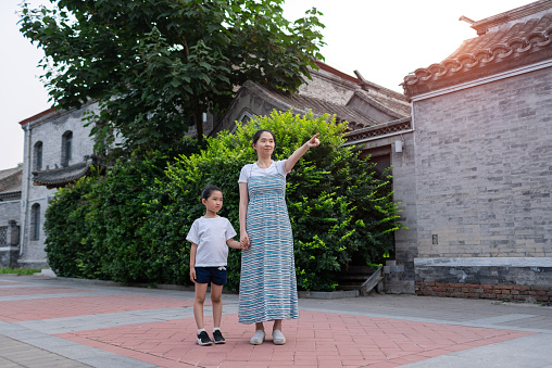 Mother and daughter touring Beijing