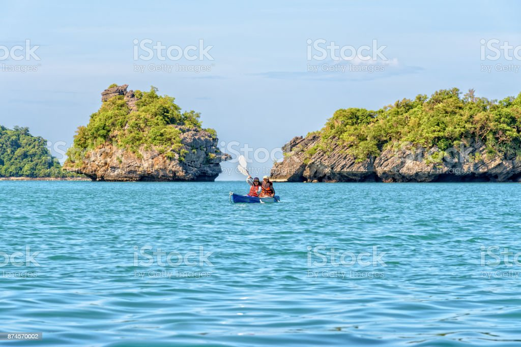 Mother and daughter travel by kayak stock photo
