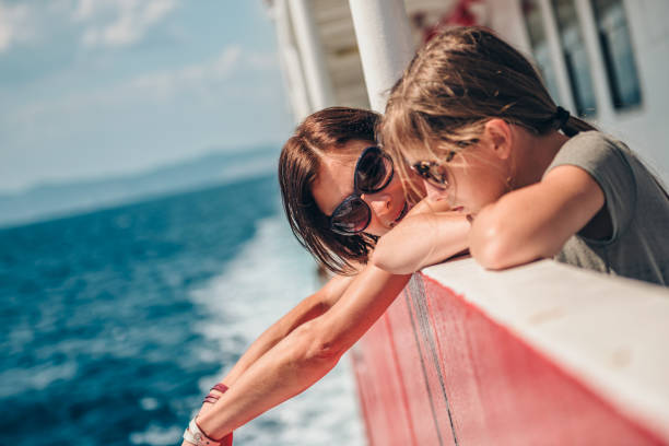 mother and daughter traveling on a ferry boat - ferry imagens e fotografias de stock