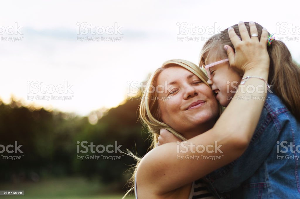 Mother and daughter unconditional love stock photo