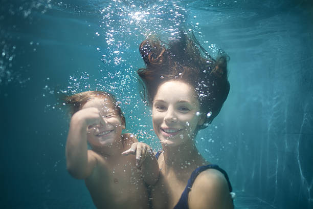 Mother and Daughter Underwater stock photo
