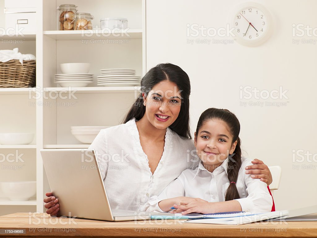 Mother And Daughter Using A Laptop royalty-free stock photo