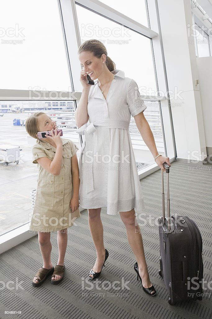 A mother and daughter using cell phones royalty-free stock photo