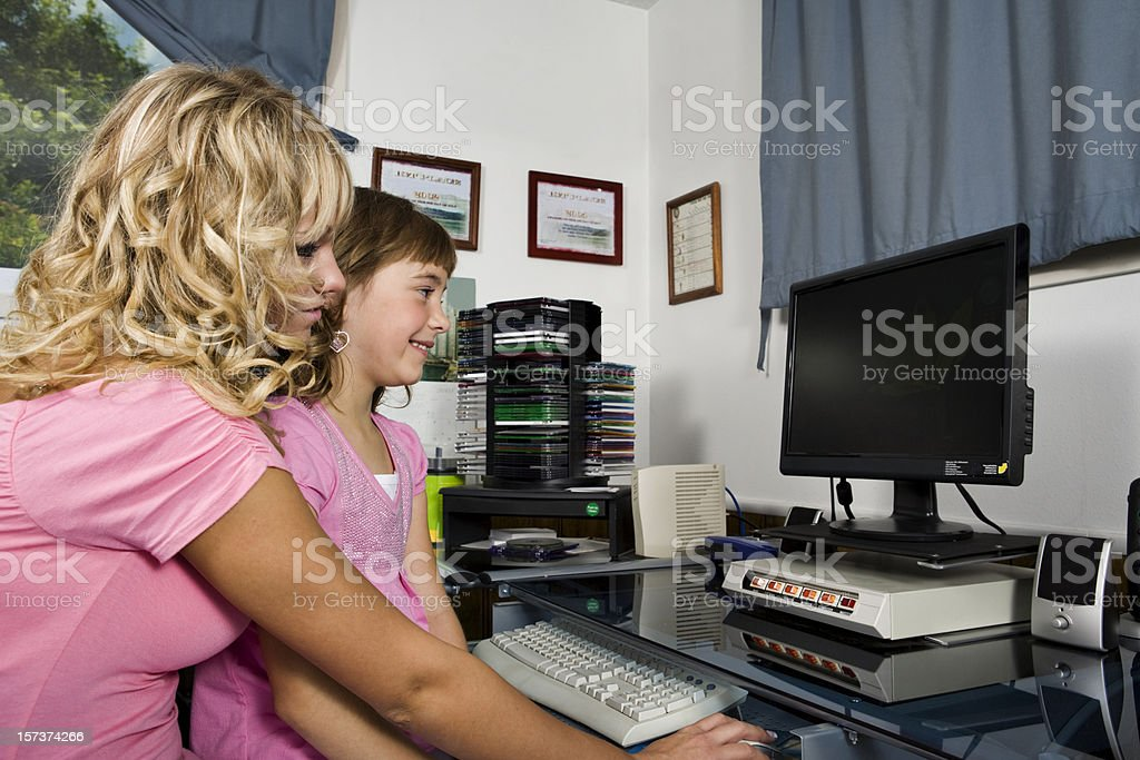 Mother and daughter using computer royalty-free stock photo