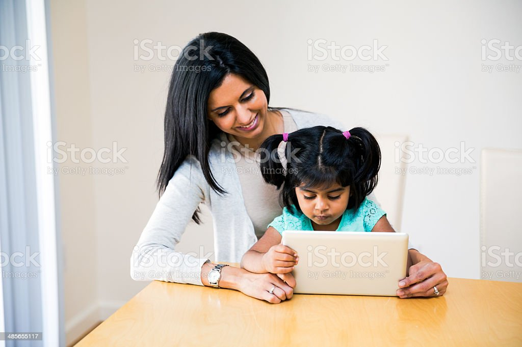 Mother and Daughter Using Digital Tablet stock photo