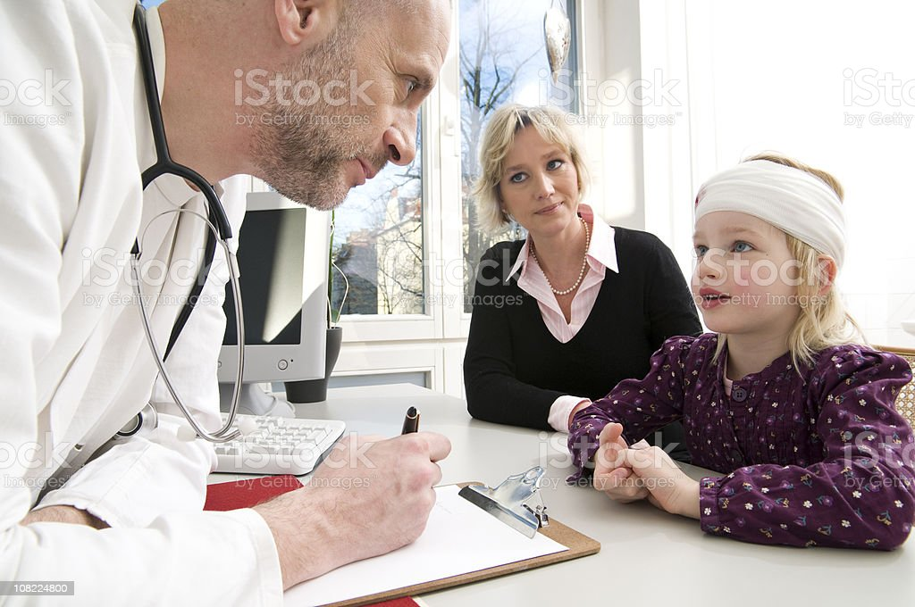 Mother and daughter visiting the doctor royalty-free stock photo