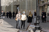 Russia, Moscow, March 19, 2020 - Mother and daughter walk down the street in medical masks that protect against viruses - influenza, coronavirus and others