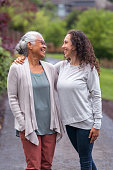 istock Mother and daughter walking in a natural parkland area. 1256012775
