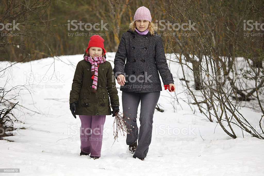 Mother and daughter walking in forest royalty-free stock photo