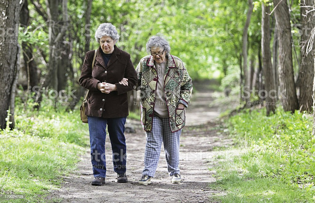 Mother and Daughter Walking Together on Nature Trail royalty-free stock photo