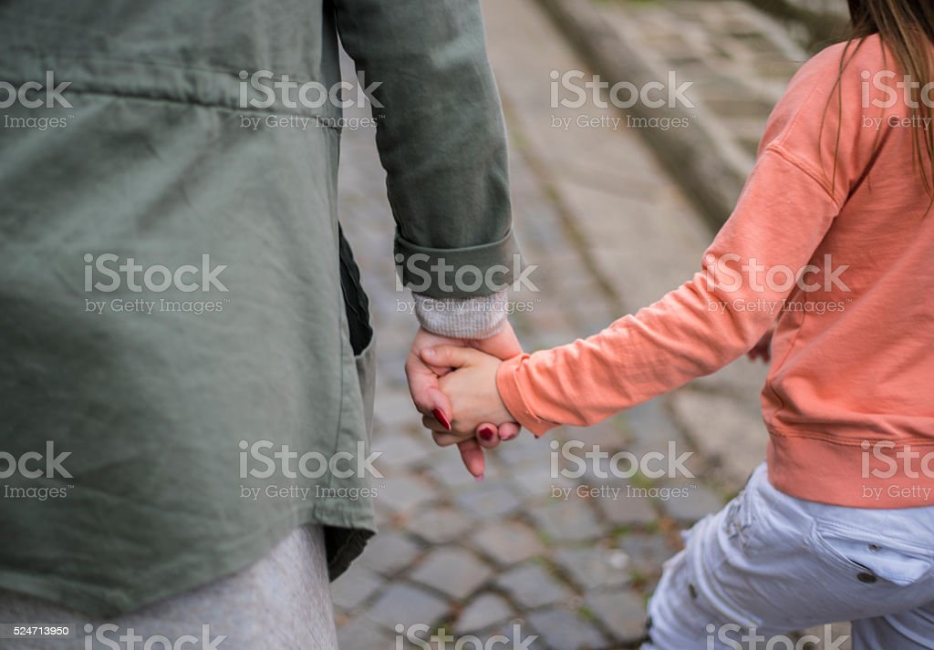 Mother and daughter walking together stock photo