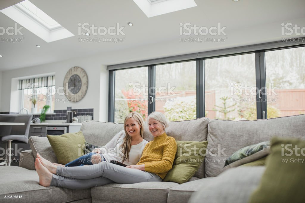 Mother And Daughter Watching Television stock photo