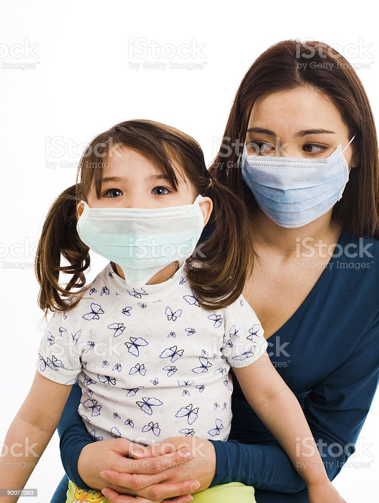 A mother and daughter wearing surgeon masks royalty-free stock photo