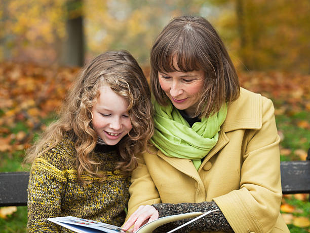 Mother and daughter with a book stock photo
