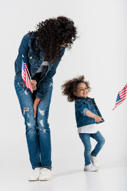 mother and daughter with american flags stock photo