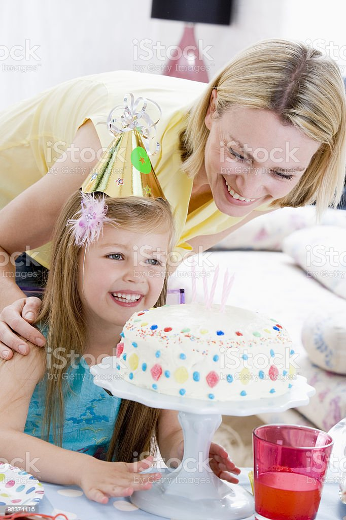 Mother and daughter with birthday cake royalty-free stock photo