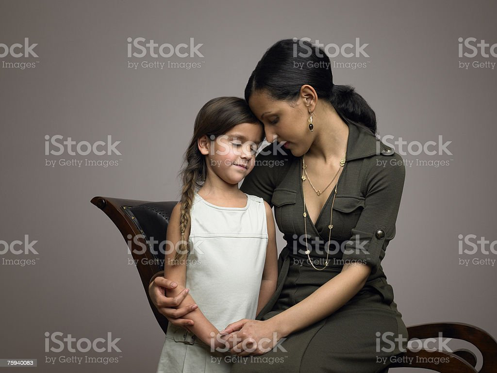 Mother and daughter with eyes closed stock photo