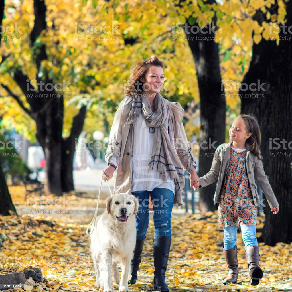 Mother and daughter with their dog in nature royalty-free stock photo