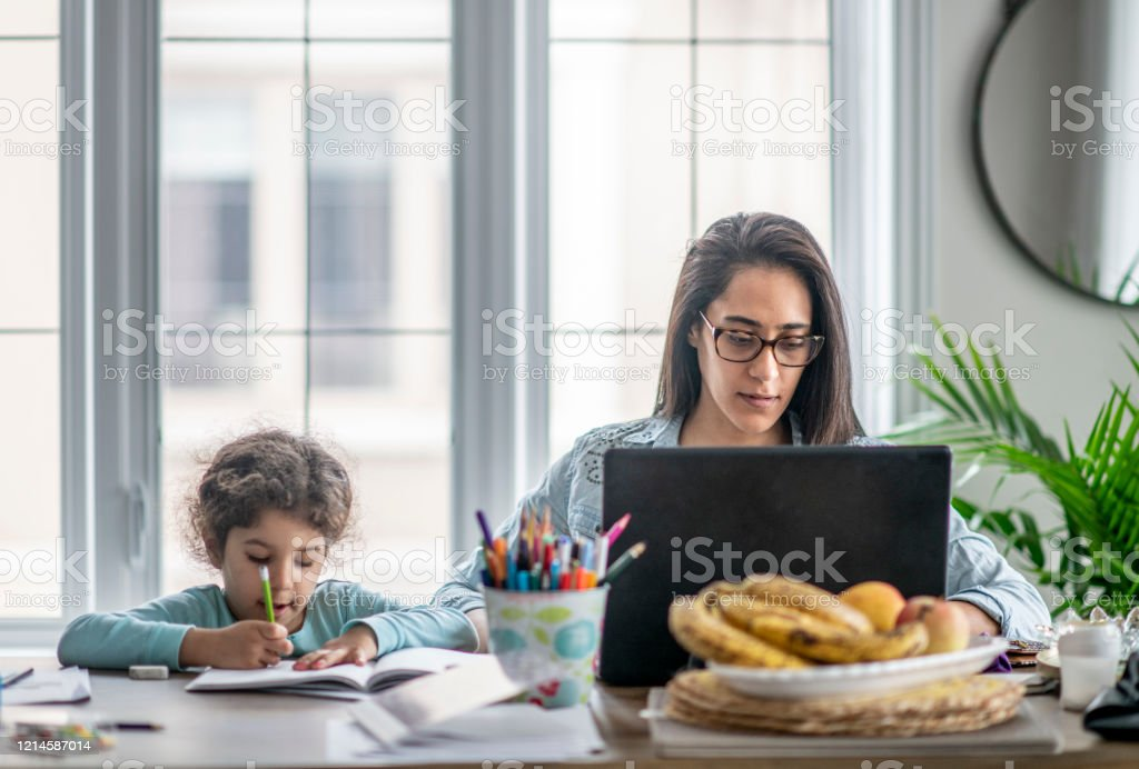 Mother and daughter working from home. - Royalty-free Avoidance Stock Photo