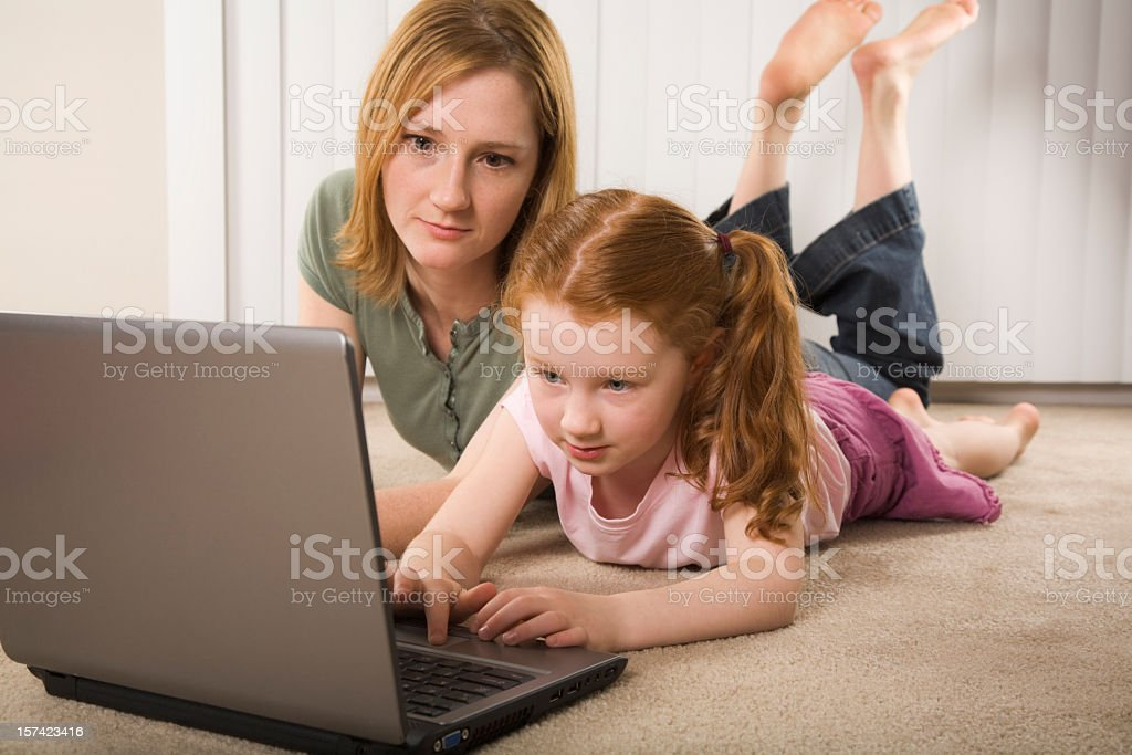 mother and daughter working with laptop computer royalty-free stock photo
