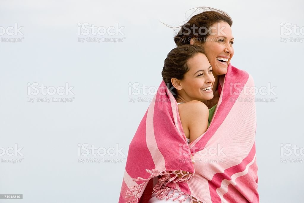 Mother and daughter wrapped in a blanket royalty-free stock photo