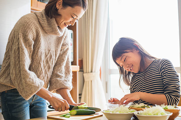 mother and daughterl preparing for lunch in home. - 母娘 笑顔 日本人 ストックフォトと画像