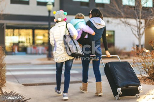 In Western Colorado Millennial Mother and her two daughters enjoy Winter Lifestyle and Travel (Shot with Canon 5DS 50.6mp photos professionally retouched - Lightroom / Photoshop - original size 5792 x 8688 downsampled as needed for clarity and select focus used for dramatic effect)