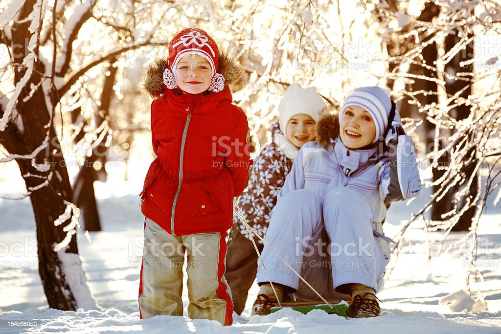 Mother and Daughters Having Fun in Winter Park royalty-free stock photo