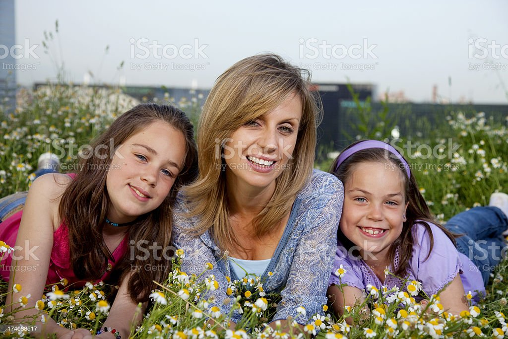 Mother and daughters in spring royalty-free stock photo