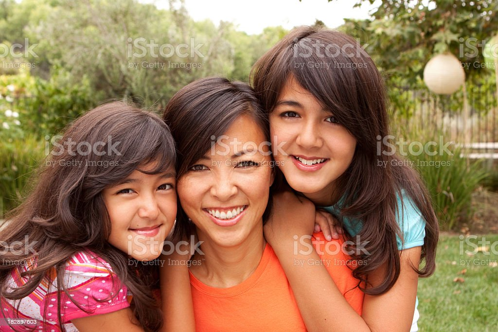 Mother and daughters stock photo