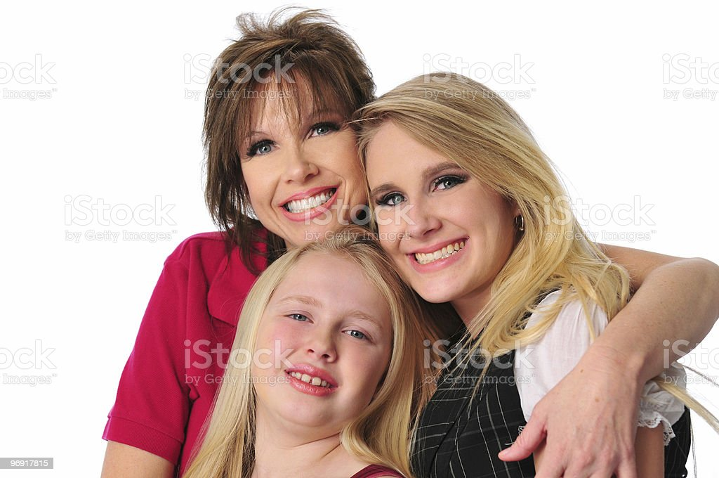 Mother and daughters smiling royalty-free stock photo