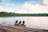 Asian mom and Eurasian daughters in Punta Laguna Nature Reserve, Tulum, Yucatan Peninsula, Quintana Roo, Mexico