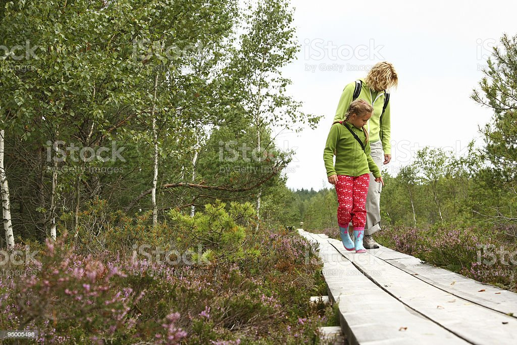 Mother and daughthter walking in forest stock photo