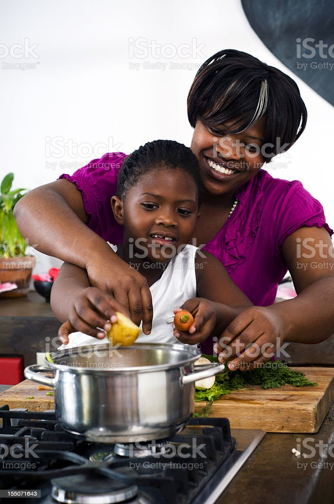 Mother and daugter cooking stock photo