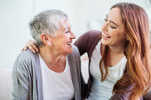 istock Mother and dauther laughing together 541974122