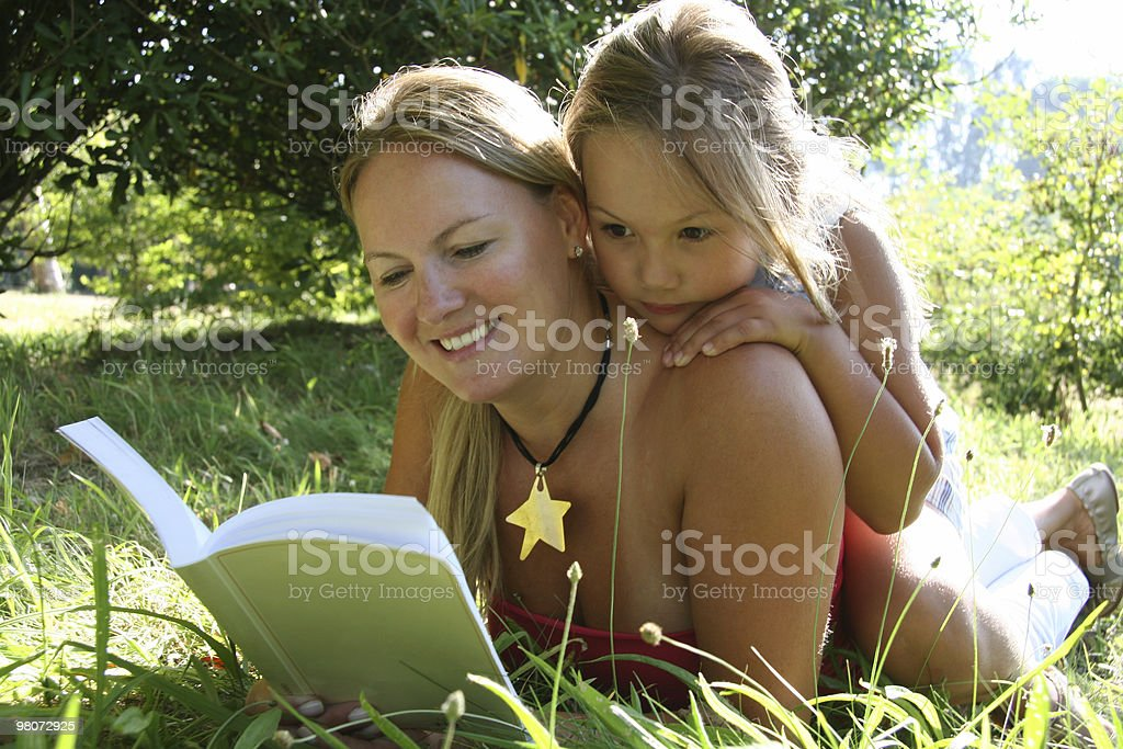 Mother and Doughter Read a Book royalty-free stock photo