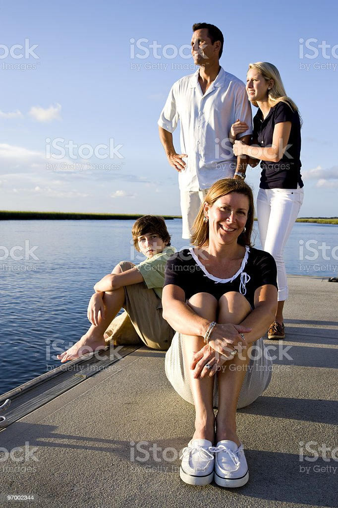 Mother and family, sunny day on dock by water royalty-free stock photo
