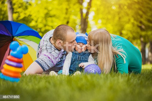 Happy family are plaing with their baby in the park