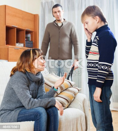 istock Mother and father scolding teenager boy 464975561