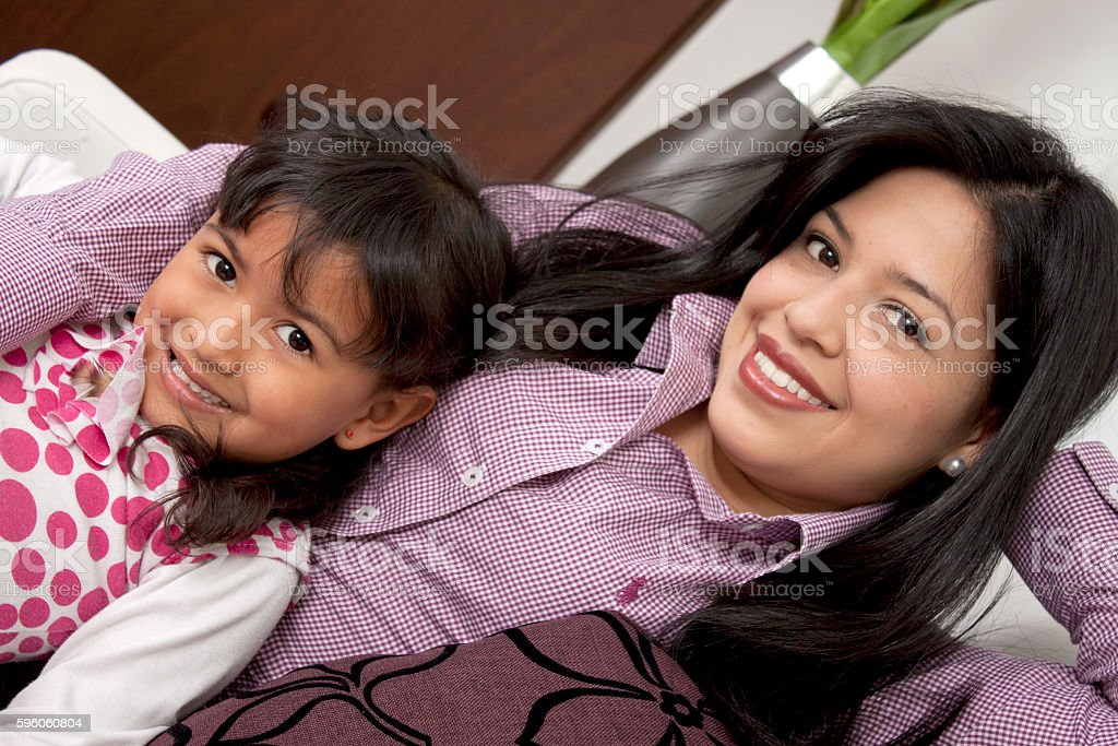 mother and girl smiling in the living room royalty-free stock photo